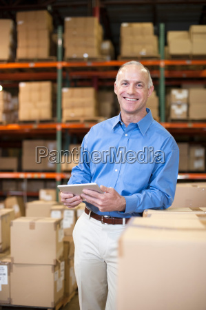 portrait of female warehouse worker with