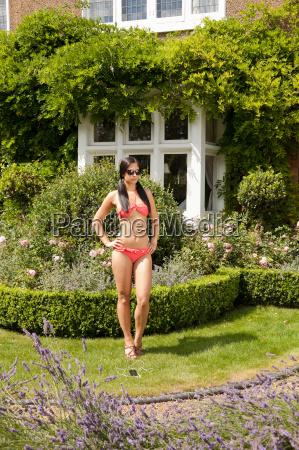 woman in bikini standing in garden