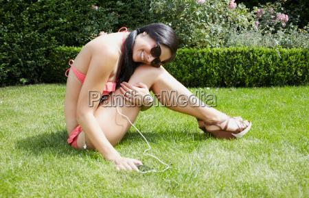 woman in bikini listening to mp3