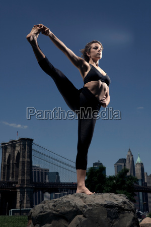 woman standing on one leg on