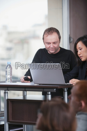man and woman working on presentation