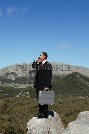 business man in the mountains