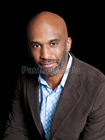 man wearing brown jacket portrait