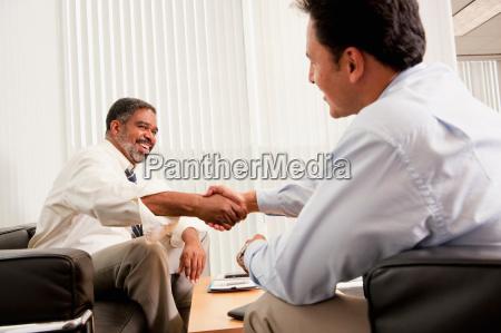 hand shake at business meeting