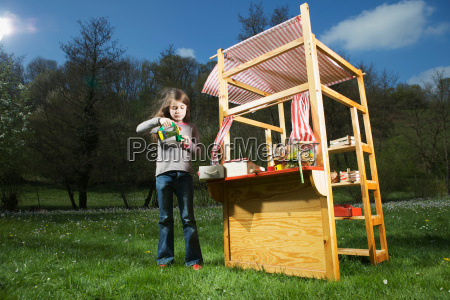 girl playing in little store