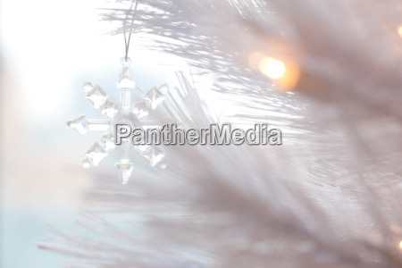 snowflake christmas decoration on christmas tree
