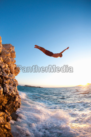 man cliff jumping