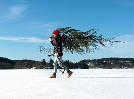 man with christmas tree
