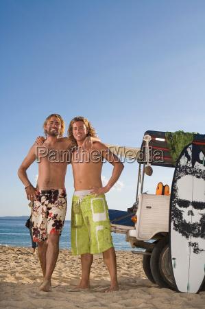 surf men portrait by jeep