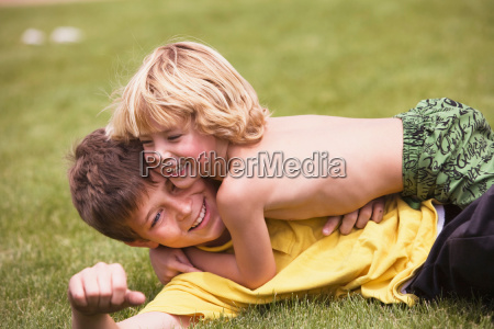 young boy wrestling with brother
