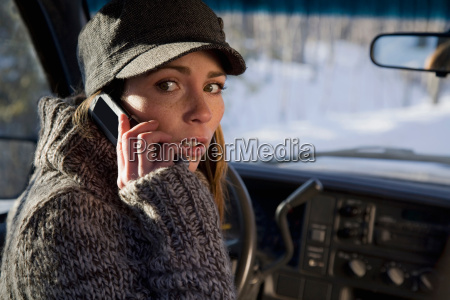 woman talking on phone in car