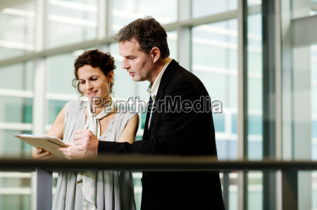 business partners looking at a file