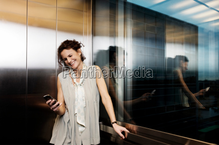 woman in elevator with cellular