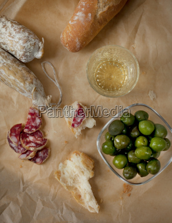 white wine green olives salami and