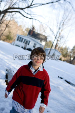 boy walking in the snow