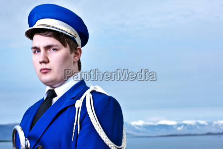 portrait of young man wearing marching