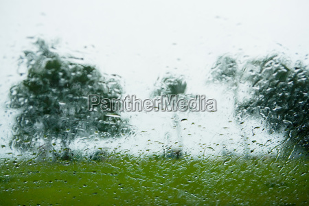 raindrops on window and view of