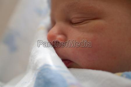 newborn baby boys face close up
