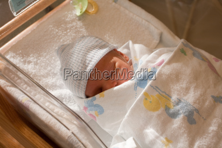 newborn baby boy in hospital crib