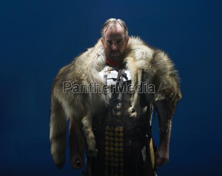studio portrait of gladiator wearing wolf