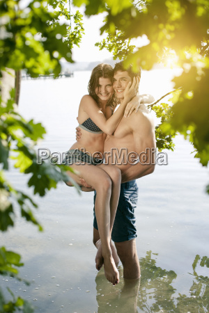 portrait of young couple paddling in