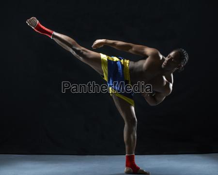 studio shot of young male kick