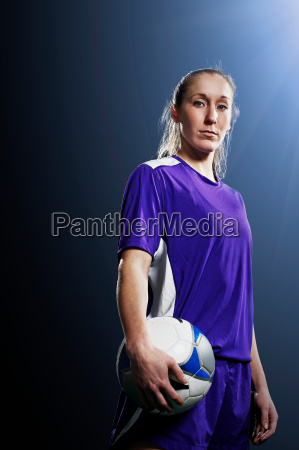 studio shot of young female soccer