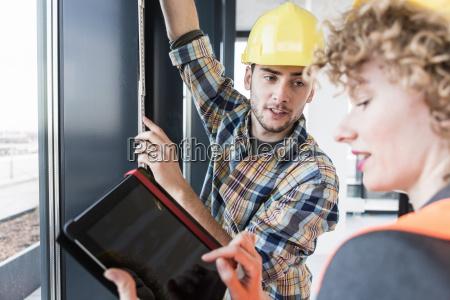 builders using digital tablet inside new