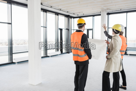 group of people in empty office