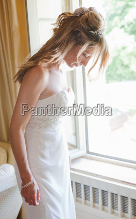 mid adult bride in white wedding