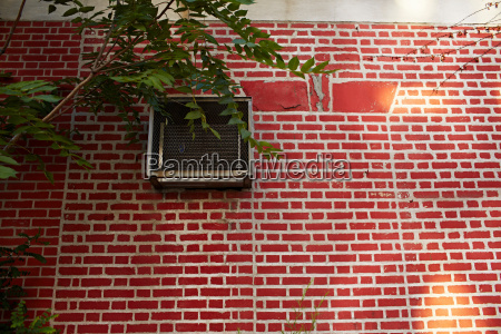 red brick wall with air vent