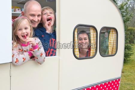portrait of family in caravan