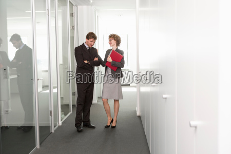 businesswoman with hand on male colleagues