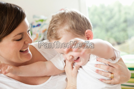 mother playing with toddler son