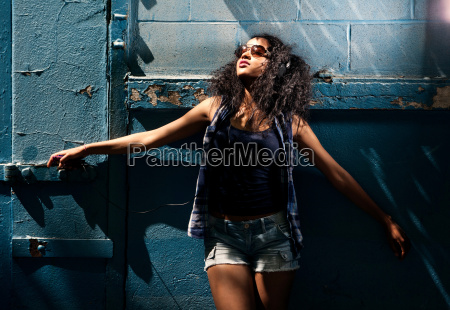 young woman wearing sunglasses in urban