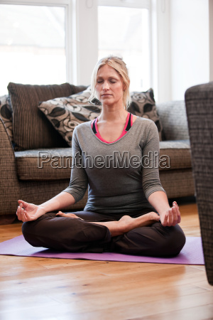mid adult woman in yoga pose