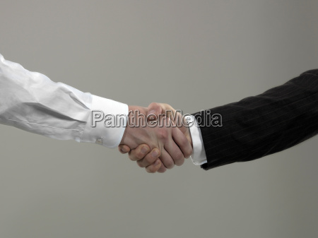 business men shaking hands close up