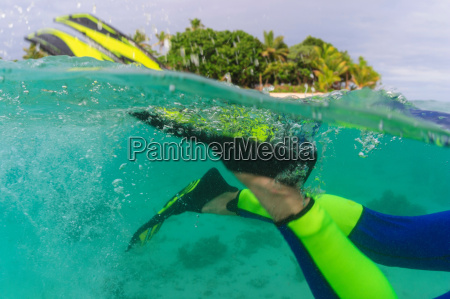 close up of snorkelers fins underwater