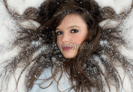 beauty young woman portrait in snow