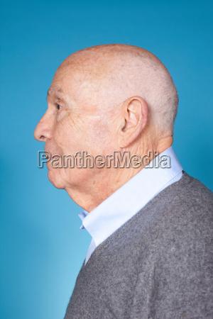 senior man profile studio shot