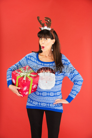 woman in antlers tiara holding christmas