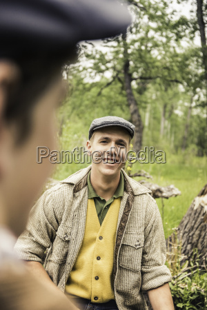 young man wearing flat cap looking