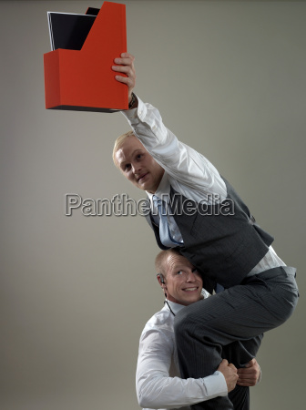 business, men, placing, paper, holder - 19474800