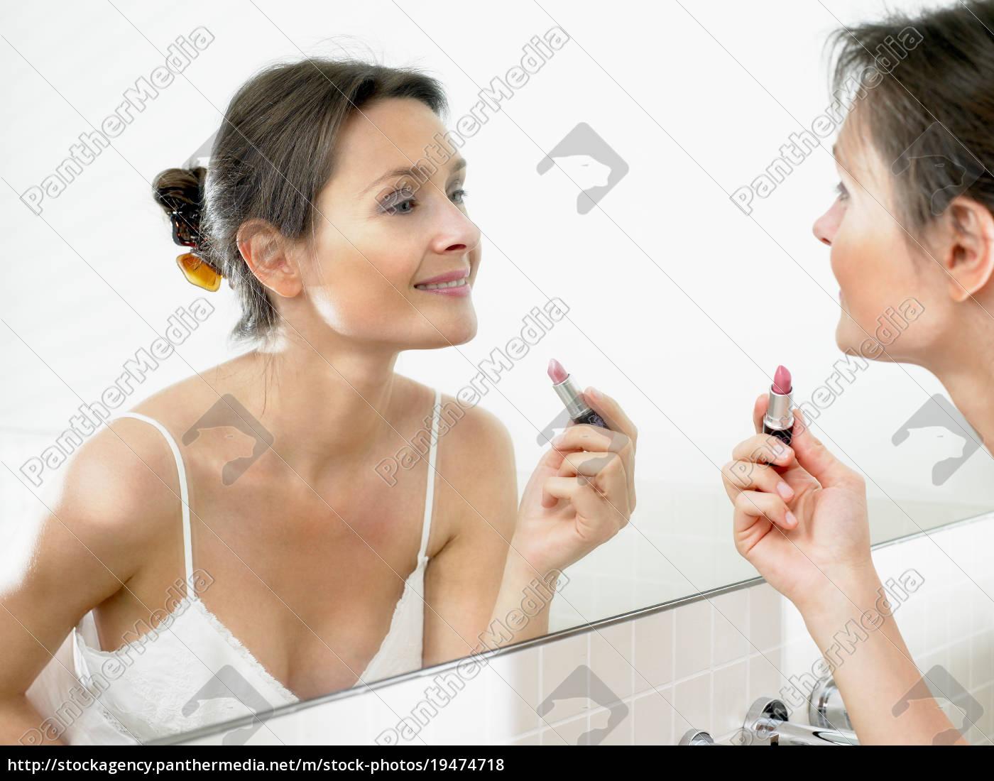 woman, in, bathroom, , applying, makeup - 19474718