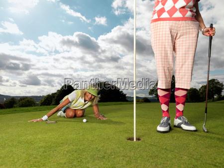 mature ladies playing golf