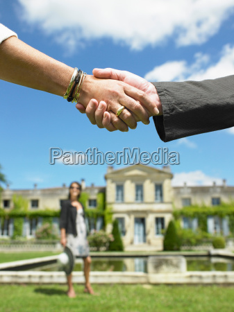 people shaking hands after a sale