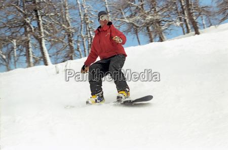 maennlich reiten snowboard