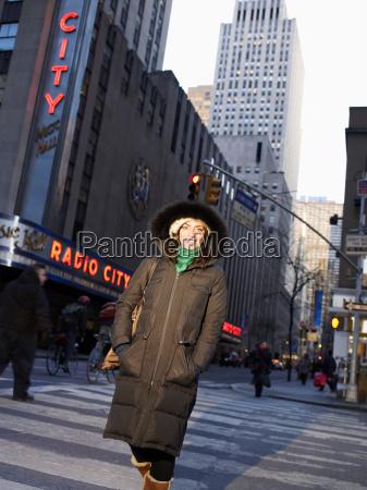 woman crossing new york street