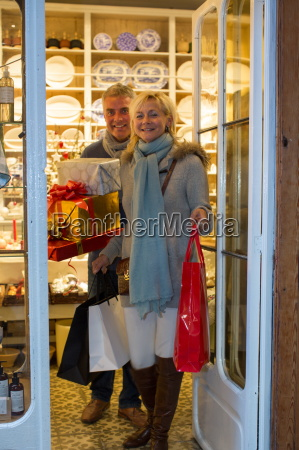 mature couple leaving gift shop with