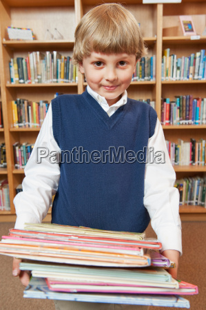 student in school library